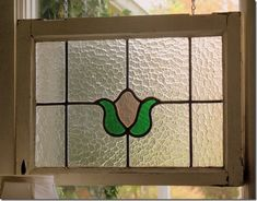 step by step tutorial on how to make a faux stained glass window hanging that looks vintage