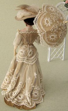 Stunning costume and parasol on a vintage Victorian doll