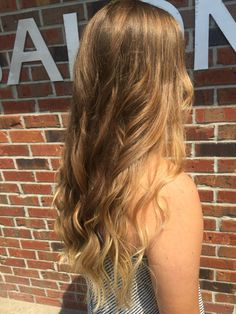 I did some balayage highlights around her face for a natural, sun kissed look