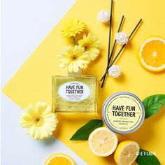 Perfume flat lay with shades of yellow and lemon