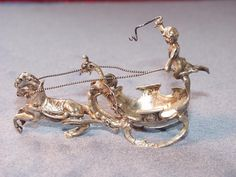 Very fine silver salt cellar , probably Viennese first half of the 19th century in form of a chariot with Putto.The item is very fine crafted,