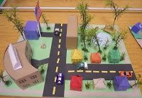 Students make their own urban, suburban, or rural communities out of construction paper