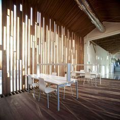 architecture - Warmth and Texture Reclaimed Wood Wall in a Modern Mexico Apartment Public Library Architecture, Public Library Design, Architecture Design, Facade Design, Wall Design, Exterior Design, Library Cafe, Light Architecture, Design Art