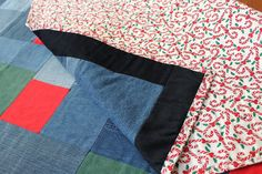 Bright red and green incorporate the colors from our throw quilt's #candycane backing into the sea of blue denim that forms our quilt's top. #Christmas Denim Quilt Throw Candy Canes & by HandiworkinGirls, $179.95