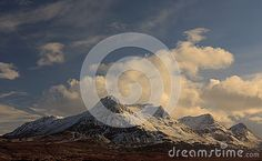 Scenic view of snow capped Ben Loyal mountain in winter, Highlands, Scotland.