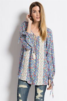 """Perfect tunic for a fall day, featuring soft, floral print with crochet tape and tassel front. Complete your look with your favorite jeans. 100% Rayon Machine wash gentle Hang dry S M L Bust 20"""" 21"""" 2"""