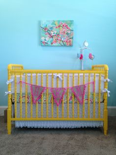 Yellow Jenny Lind crib painted with Krylon - Rust-oleum // Canary Yellow Wall color: Benjamin Moore // Seafoam Canvas: Oopsydaisy.com