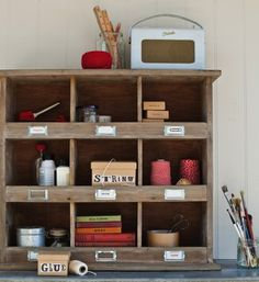 i like this simple, open organization for art supplies.  and i LOVE the Roberts Radio on top.  Just can't justify spending that kinda money for a radio when we don't even have that many stations.