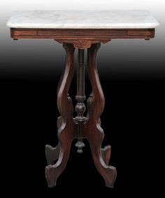 """Victorian Furniture Price Guide: Marble Top Victorian Antique Table: A few scratches on the white marble, but otherwise in excellent condition. Size: 30"""" tall. Value: $143.75"""