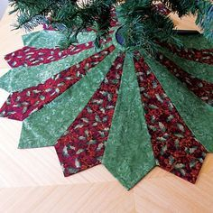 Dresden Tree Skirt with Tree, or collect red & green neckties that seem to complement pretty well together...? The website shows you how to sew and create the tree skirt.