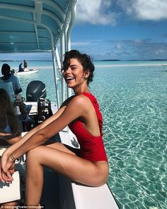 'Not crabby about this on set with @calzedonia': Georgia Fowler, 25, looked every inch the budding supermodel as she posed in a bright red swimsuit during a photo-shoot in The Bahamas this Thursday