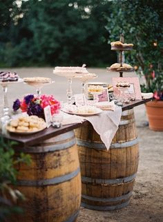 Wine Barrels for a wedding cocktail hour! Very easy to do and adds a sweet vintage charm. Most used barrels about to be retired can be priced up to about $125 so if you can find some from older or smaller wineries that are about to be broken down.