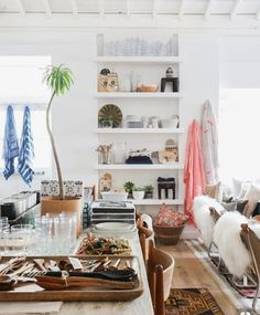 12 Inspiring Ways To Creatively Display Your Textile Collection – Lamour Artisans Amber Interiors Shoppe, African Living Rooms, Sunflower Kitchen Decor, Ikea Curtains, Ikea Frames, Interior Design Studio, Retail Design, Ideal Home, Home Goods