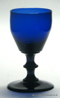 A Bristol blue port glass c1830 with an ogee bowl above an angular knop stem and conical foot with a snapped pontil. English lead, no chips cracks or restoration, it measures 4 inches tall with a 2 1/16 inch bowl and 2 3/8 inch foot. http://scottishantiques.com/georgian-wine-glasses/regency-coloured/glass-auction2#.Vj8HxaToq-4