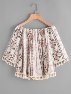 Half Sleeve Blouses. Top Decorated with Fringe. Designed with Boat Neck. Oversized fit. Perfect choice for Boho wear. Floral design. Trend of Summer-2018. Designed in Multicolor. Fabric has no stretch.