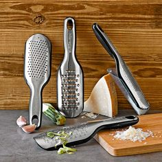"MULTI-FUNCTIONAL ELITE PADDLE GRATERS from Williams-Sonoma (mfg Microplane).  ""Originating as a smoothing tool for woodworkers, the Microplane proved to be an indispensable grating and shredding tool in the kitchen. We offer four versions for handling an array of prep tasks."""