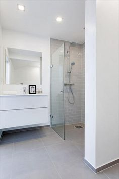 Like the cabinets raised off the floor and the main floor even with the shower floor. #bathroom. White. Grey. Tile