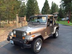 From the front.   Khaki 1991 Jeep Wrangler Sahara. 4.0L I6 with 5-speed manual transmission and only 29,XXX miles.  Purchased by my uncle new in December 1990 and recently