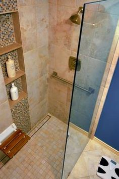 WSJ Encore Special on Aging in Place: Hope to Stay in Your Home?  Excellent read and resources for baby boomers and multigenerational families modifying residences and aging successfully. This photo is an example master bath where the shower has a curbless entry, fold-up seat and grab bar. WSJ.