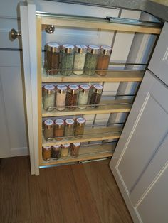 A closeup of that useful spice rack - Notice that the Martha Stewart Living hardware is a nickel finish.