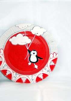 Ceramic penguin plate hand painted in red
