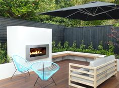 As much as the liking the fireplace, this a really well designed outdoor space with clean lines and simple planting. Escea EF5000 outdoor gas fireplace