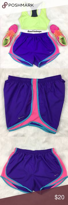 Nike Dri-Fit Running Shorts Run in style! These lightweight shorts are ideal for any type of exercise. The bright neon colors are fun and exciting. It has a drawstring and built in underwear. Nike Shorts