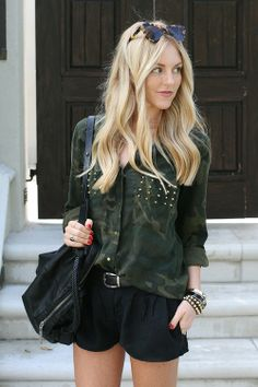 army top w/ studs + black shorts.