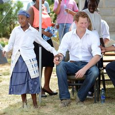 Prince Harry during a visit to the Kananelo Centre for the Deaf - he is definitely in demand :-)