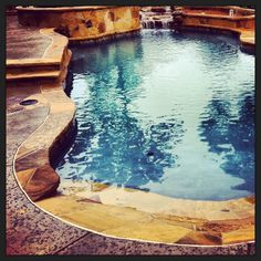 Custom lagoon style radius pool with chopstone flagstone coping, spa hot tub, waterfall water feature, designed and constructed by Preferred Pools. www.preferredpoolstyler.com