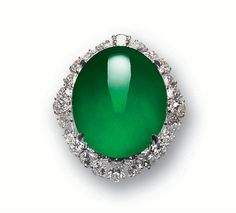 Important Jadeite and Diamond Pendant/Ring       The split shoulders embellished with pave-set brilliant-cut diamonds, mounted in 18 karat white gold. (See pendant for price)