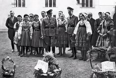 Hans Frank, the Nazi governor of the part of Poland incorporated into the Reich, receives gifts from the populace on the occasion of a harvest festival in Krakow, 1943.