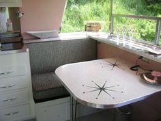 I like the shelf above the table in the camper. We may make this our reality.