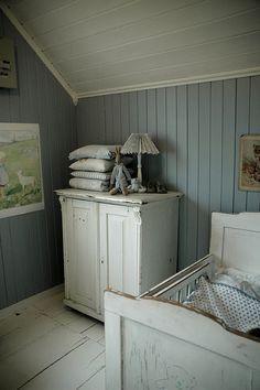 Antique white server, nursery, slate wood walls