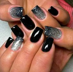 Black and silver Ombre nail art. This elegant nail art design consists of a matte black polish and silver glitter polish to enhance the Ombre effect on the nails.
