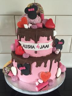 Chocolate drip birthday cake with minnie mouse