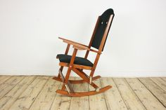 Folding rocking chair reupholstered black and white buttons, original vintage mid century rocking chair, nursery, mcm chair, folding chair by VintageVitrineShop on Etsy https://www.etsy.com/listing/228292758/folding-rocking-chair-reupholstered