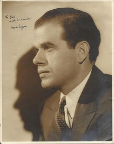 CAPRA FRANK: (1897-1991) Italian-American Film Director, Academy Award winner. Vintage signed and inscribed sepia 7.5 x 10 photograph of Capra in a semi-profile head and shoulders pose. Signed in dark fountain pen ink across a light area of the background.