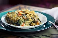 Parmesan Spinach Casserole with Garlic Brown Rice- need to try this, but without the carrots