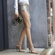 """""""Daytime Drama at its best: meet the EXCITE bootie and the EMPIRESMALL bag. Shop the link in our bio. #inourshoes"""""""