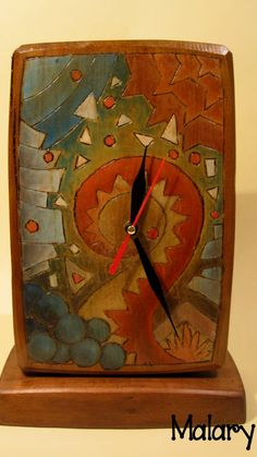 Wooden carved clock by Malaryhandweaving on Etsy