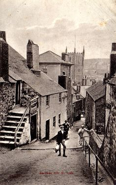 Postcard showing Barnoon Hill, St Ives, Cornwall. In the foreground stands a boy holding a milk jug. St Ia Church can be seen in the background. - Collections - Penlee House Gallery and Museum Penzance Cornwall UK