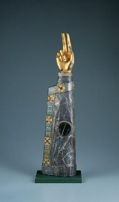 Reliquary Arm-Kimbell Museum  French  12th century    c. 1150–1200 (crystal possibly added in the 15th century)        Silver, champlevé enamel on copper, gilt bronze, wood core, glass cabochons, and crystal        24 7/16 x 6 x 3 7/8 in. (62.1 x 15.3 x 9.9 cm)        AP 1979.25