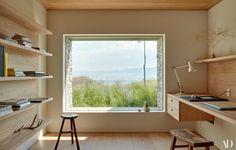 The study features custom Douglas-fir shelving.