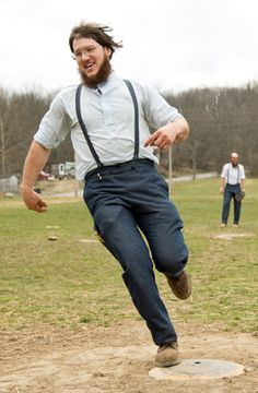 Rare look inside Amish community.  Taking a break from a hard day's work to play some baseball.