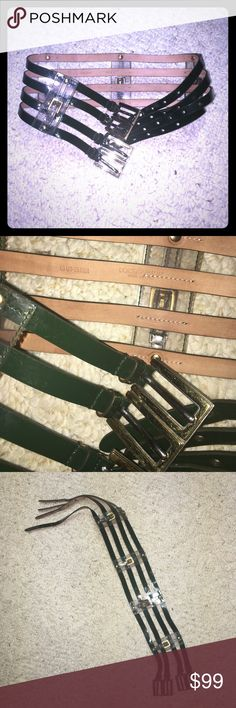 100% authentic Dolce & Gabbana leather belt XS 100% authentic Dolce & Gabbana leather corset belt in size 26, 65 cm, it fits more 0-2 or XS-S. It's not black, dark green color with jelly connections and gold buckles. Used but in great condition, very rare and unique item! Unfortunately I don't have any box or dust bag Dolce & Gabbana Accessories Belts