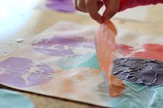 toddler friendly, less messy painting - cover paper with tissue paper and let child paint over it with water, colors bleed through