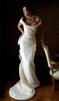 Sheath wedding gown with small bustle