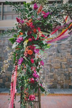 purple anf orange floral ceremony arch for fall wedding