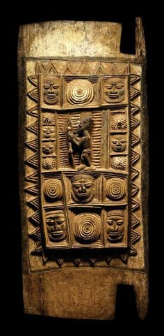 Africa   Wooden door (ilekun) by Nigerian Yoruba master carver, Olowe Of Ise. Probably for Ikéré palace   Wood; aged and varied patina decorated with red ochre and white pigments   ca. 1930s